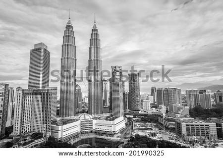 The Kuala Lumpur skyline in black and white. - stock photo