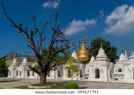 The Kuthodaw Pagoda in Mandalay. In total 729  stupas with a marble slab inscribed on both sides surround the main pagoda, thus it is believed to be the largest book in the world. - stock photo