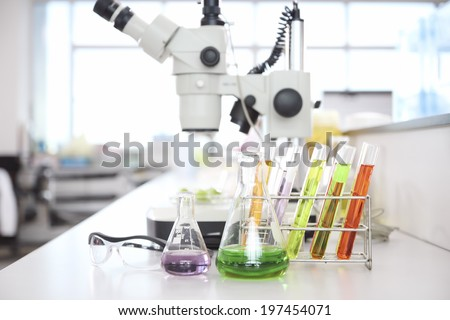 the laboratory test tubes with colorful liquid with  Microscopes In Laboratory/lab - stock photo