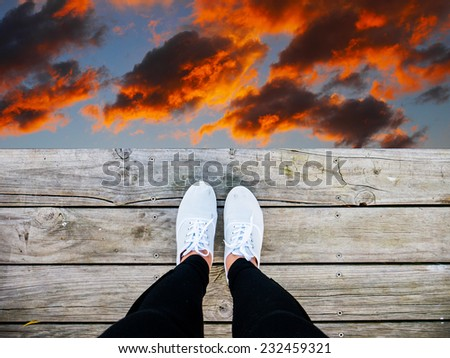 The lady jump from the wooden desk - stock photo