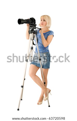 The lady - photographer is photographed on the white background - stock photo