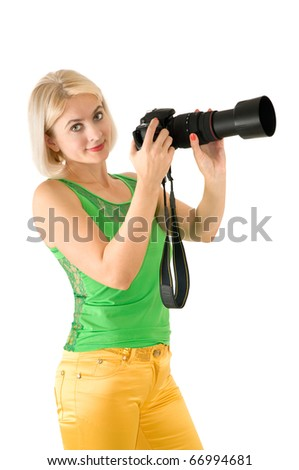The lady - photographer is photographed on the white background