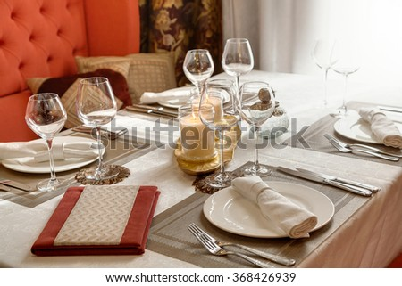 The laid table at restaurant in classical style  - stock photo