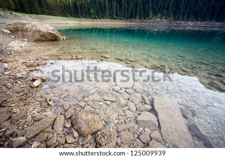 The lake in forest mountain - stock photo
