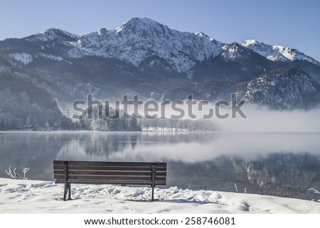 The Lake Kochel is on the edge of the Bavarian Alps at the foot of the popular hiking mountains Herzogsstand and Home Garden - stock photo