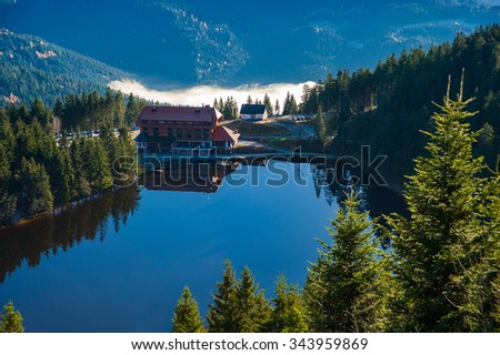The lake Mummelsee and the mountain hotel in Seebach, Black Forest, Baden-Wuerttemberg, Germany, Europe - stock photo