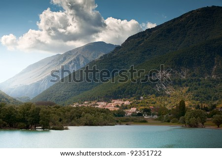The lake of Barrea and the village of Villetta in a valley deep into the mountains of Abruzzi, Italy. - stock photo