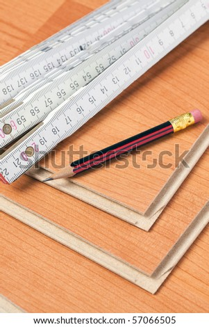 the laminate floor with wooden ruler  and pencil - stock photo