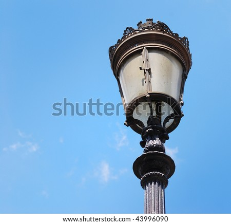 The lamppost with a blue sky background is ideal for your texts or images.