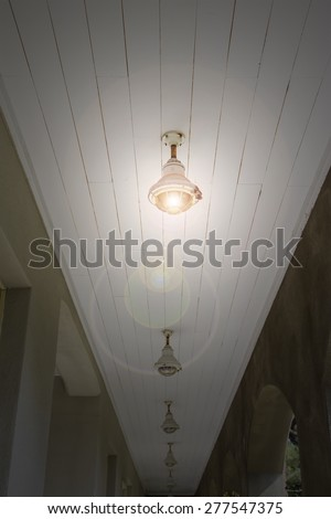 The lamps is bright on the ceiling