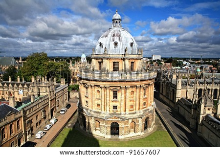 The landmark Radcliffe Camera reading room of the University's Bodleian Library in central Oxford, England, surrounded by the spires of historic colleges - stock photo