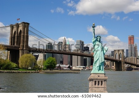 The landmark Statue of Liberty against the impressive New York City skyline. - stock photo
