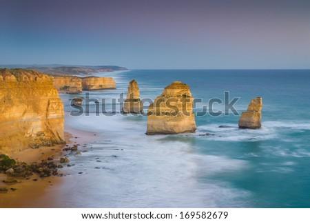 The landmark Twelve Apostles at sunset, along the famous Great Ocean Road in Victoria, Australia - stock photo