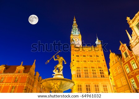 The Landmarks of Gdansk, Pomerania, Poland - the townhall and the Neptune Fountain (erected in the 17th century) - stock photo