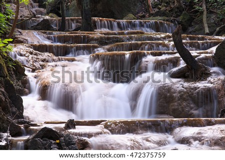 The landscape photo,  beautiful waterfall in autumn forest, Trang province, Thailand