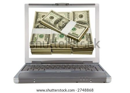 the laptop and bundle of dollars isolated with clipping path - stock photo