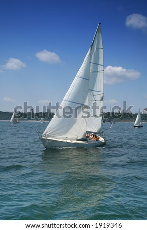 The large, beautiful yacht in the light-blue sea. A fresh wind and pleasant movement - stock photo