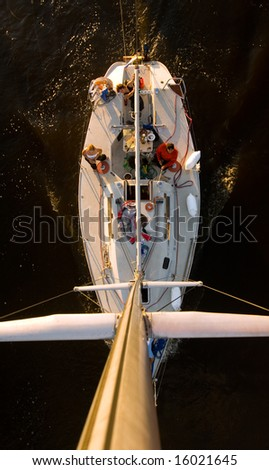 The large, beautiful yacht. Photo taken from the top of the boat pillar, 15 meters high. - stock photo