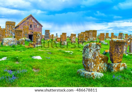 The large complex of Noratus Cemetery, located at the bank of Sevan Lake among the green meadows of Gegharkunik Province, Armenia.
