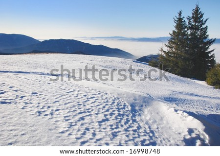 The large flat snow area in the mountains with interesting snow texture