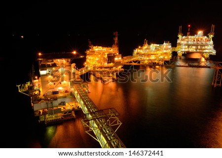 The large offshore oil rig at night in gulf of thailand - stock photo