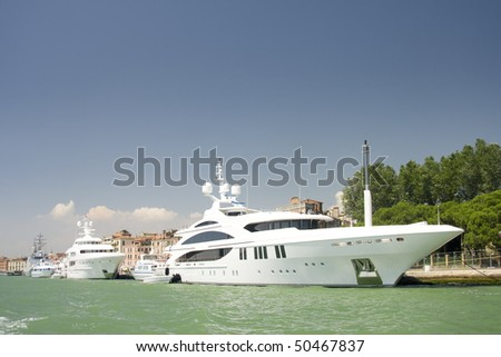 The large white luxurious yachts alongside the dock at Mediterranean Sea, Italy - stock photo