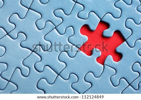 The last missing piece of jigsaw puzzle concept for solution and completion - stock photo