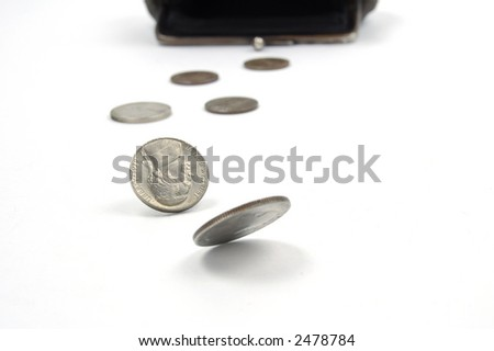 The last money?  -)american coins running from old suede purse on the white background - stock photo