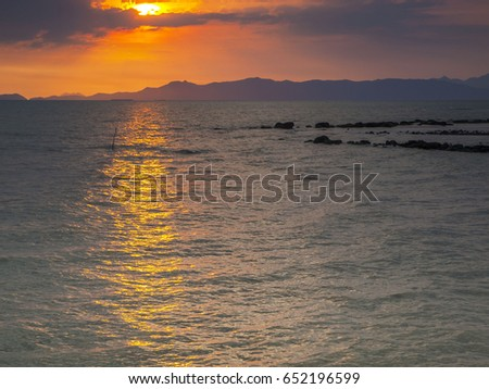 The last of the setting sunlight streaks across the ocean at Laem Sok near Ko Chang island, east Thailand