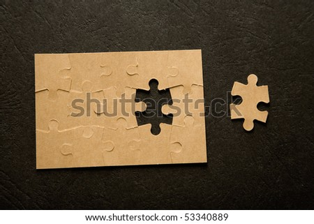 The last piece of a puzzle game, details - stock photo