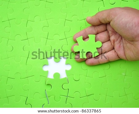 The last piece of jigsaw puzzle - stock photo