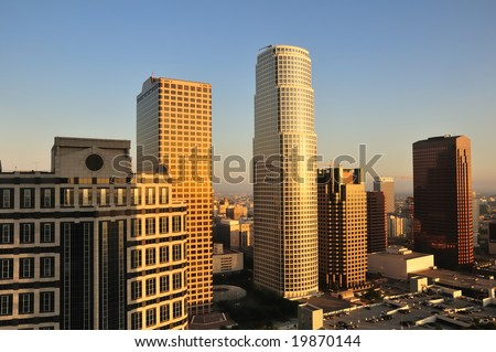The last rays of the sun fall on the hazy expanse of Los Angeles - stock photo