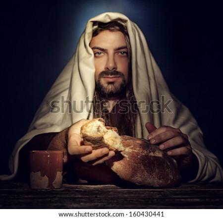 The Last Supper, Jesus breaks the bread. - stock photo