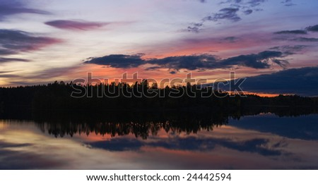 The late evening on lake after a sunset - stock photo