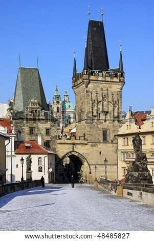 The late Snow in March Prague â?? view on St. Nicholas' Cathedral with the Bridge Tower