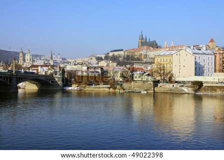 The late Snow in Prague - gothic Castle above the River Vltava