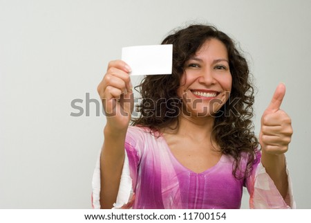 The Latin Woman with a card in a hand. Gesture