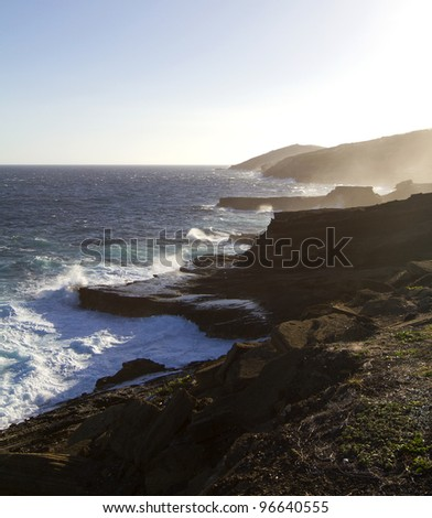 The lava coastline on Oahu with high surf - stock photo