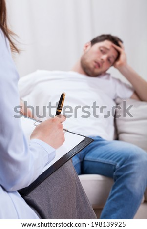 The lazy man at psychotherapist room, vertical - stock photo