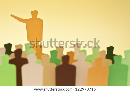 The leader showing the way to the crowd - stock photo