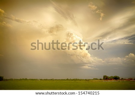 The leading edge of a Colorado thunderstorm showing it massive ugly scary head in the sky at sunset. - stock photo