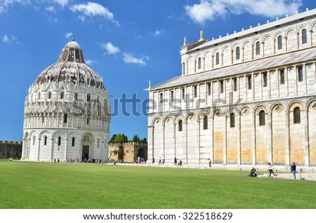 The leaning baptistery and part of the duomo (cathedral) in the piazza dei miracolo, at Pisa, Italy - stock photo