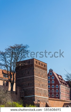 The Leaning Tower in Torun, medieval turret named after its deviation from the vertical of 1.46 m. The Medieval Town of Torun is listed among UNESCO World Cultural and Natural Heritage sites. - stock photo