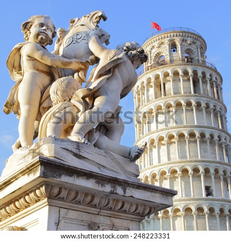 The Leaning Tower of Pisa and La Fontana dei Putti Statue, Italy. - stock photo