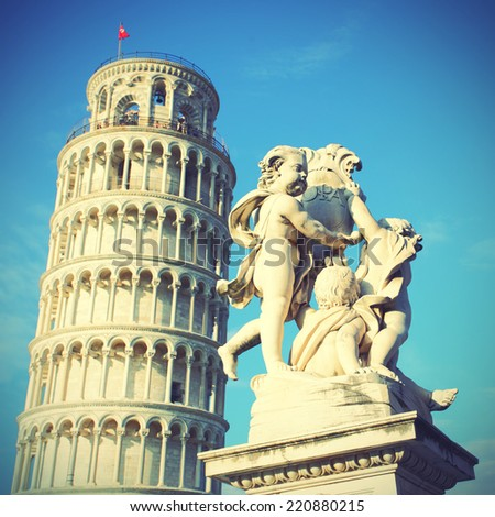 The Leaning Tower of Pisa and La Fontana dei Putti Statue, Italy.  Instagram style filter - stock photo