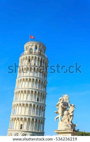 The Leaning Tower of Pisa and the Fontana dei Putti (Fountain with Angels), famous tourist attraction in Italy