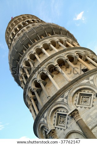 The Leaning Tower of Pisa tilts famously at an angle of 3.99 degrees. - stock photo