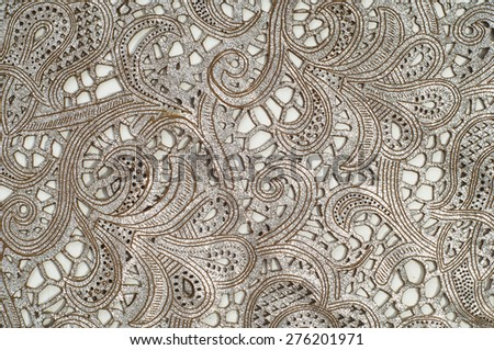 The leathertexture with a broken red lace pattern. - stock photo