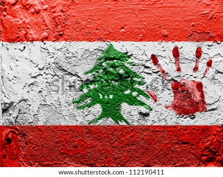 The Lebanese flag painted on grunge wall with bloody palmprint over it - stock photo