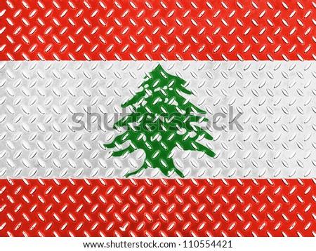 The Lebanese flag painted on metal floor - stock photo